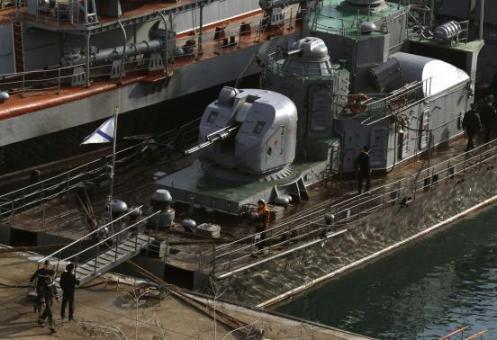 Russian sailors stand onboard the ship Suzdalets at the Crimean port of Sevastopol